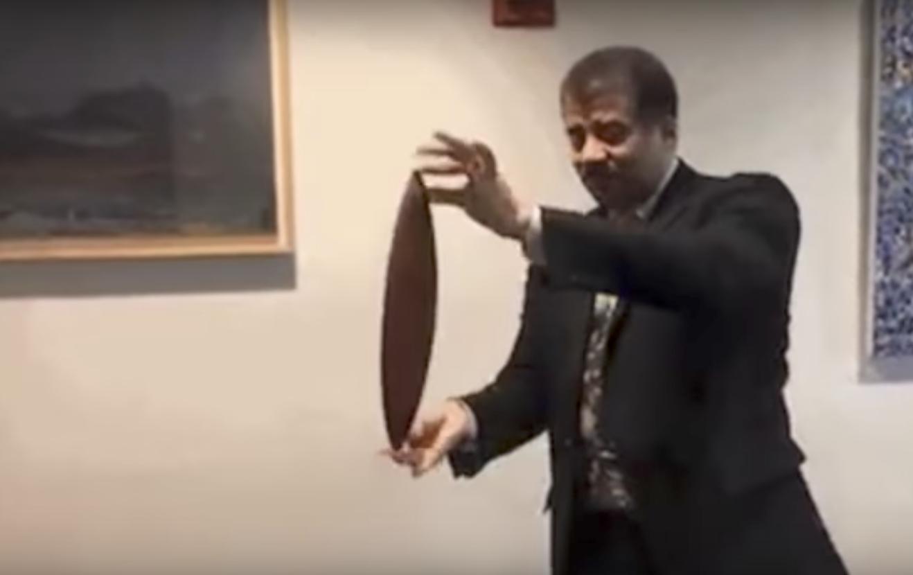 Neil deGrasse Tyson Demonstrates the Physics-Defying Rattleback
