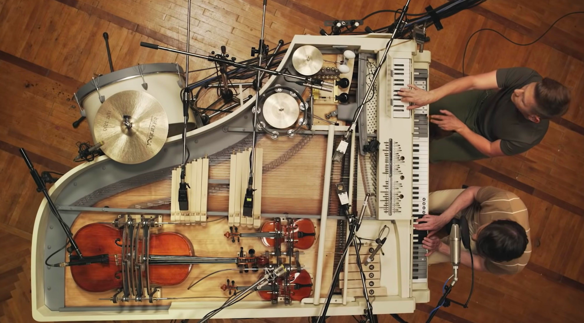 A Vintage Grand Piano Gets Reengineered to Play 20 Different Instruments with a Push of Its Keys
