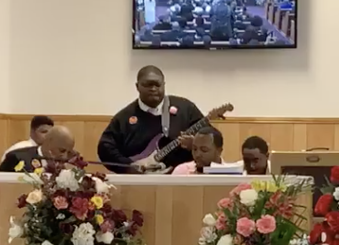 """Blues Musician Plays a Soul-Stirring Version of """"Amazing Grace"""" at His Mother's Funeral"""