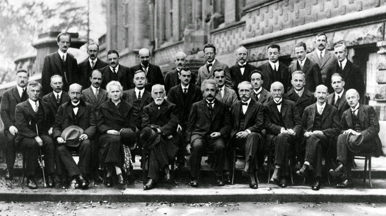 """The Most Intelligent Photo Ever Taken"": The 1927 Solvay Council Conference, Featuring Einstein, Bohr, Curie, Heisenberg, Schrödinger & More"