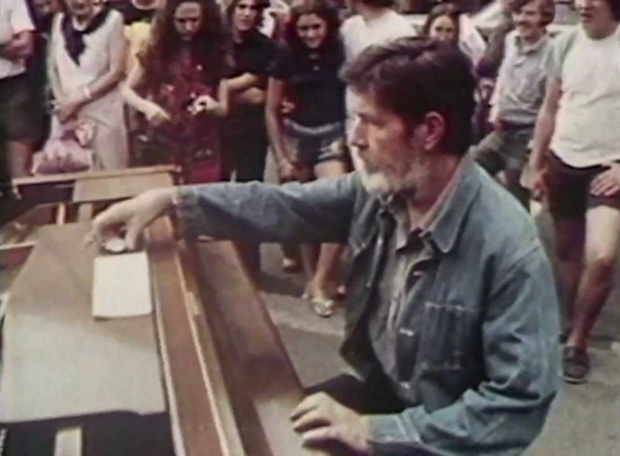 """Watch John Cage Play His """"Silent"""" 4'33"""" in Harvard Square, Presented by Nam June Paik (1973)"""